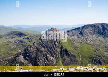 View to Mount Tryfan north ridge and peak with Glyder Fach beyond seen from Pen yr Ole Wen in mountains of Snowdonia - Stock Image