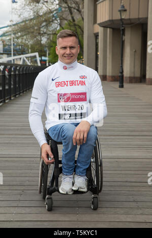 London, UK. 25th Apr 2019. David Weir(GB) attends The London Marathon Wheelchair Athletes Photocall which took place outside the Tower Hotel with Tower Bridge in the background ahead of the Marathon on Sunday. Credit: Keith Larby/Alamy Live News - Stock Image