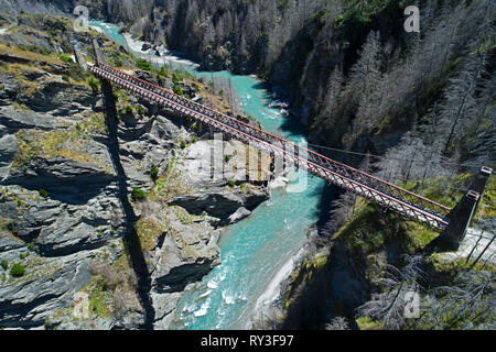 Historic Skippers Suspension Bridge (1901), above Shotover River, Skippers Canyon, Queenstown, South Island, New Zealand - aerial - Stock Image