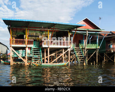 Stilted homes in Kampong Phluk floating village on Kamoong Phluk River Siem Reap Cambodia Asia home to approximately 3000 predominately Khmer fishing  - Stock Image