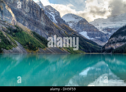 Mountains and glaciers reflected in the idyllic azure glacial waters of Lake Louise, Alberta, Canada - Stock Image