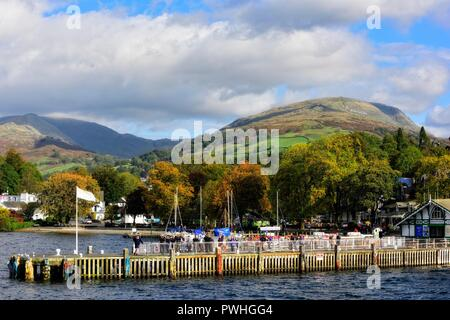 Waterhead boat jetty,tourists queuing for the next departure,Ambleside,Lake district,Cumbria,England,UK - Stock Image