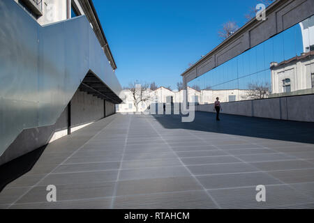 Mirrors and reflections in one of the courtyards of the Fondazione Prada, Milan, Italy - Stock Image