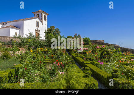 Igreja de Santa Maria medieval Church in Marvao, Alto Alentejo, Portugal. Used as Municipal Museum. Seen from box hedge garden close to the castle - Stock Image
