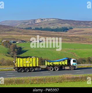 Cumbria County Council Waste Group HGV and Trailer. M6 Northbound carriageway, Shap, Cumbria, England, United Kingdom, Europe. - Stock Image