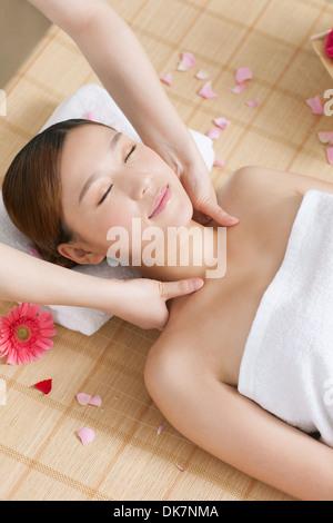 A young woman enjoy massage - Stock Image