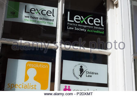 Local legal practice.  Window of firm of solicitors with notices indicating accreditation from the Law Society.  Wolverhampton, West Midlands, UK, - Stock Image