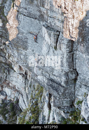 Rock climbers on the Africa Crag rock face just below the summit of Table Mountain in Cape Town. - Stock Image