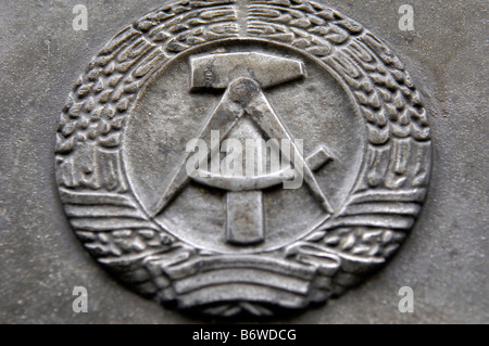 DDR insignia badge communist hammer - Stock Image