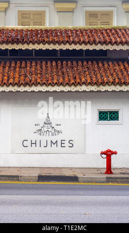 Fire hydrant on Bras Basah road and sign for CHIJMES function event centre Singapore. - Stock Image