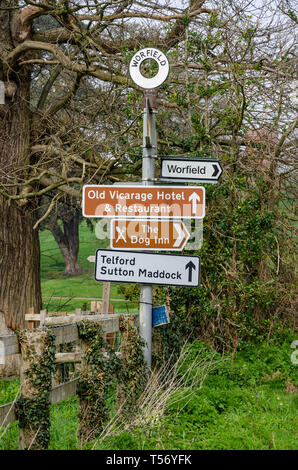 A signpost at the village of Worfield in Shropshire, UK - Stock Image