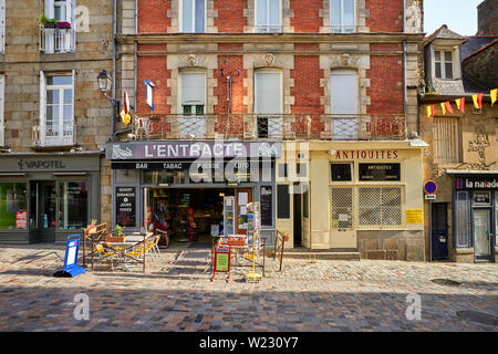 Shops near the Victor Hugo theatre in Fougères, Brittany, France - Stock Image