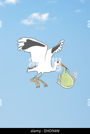 Stork flying in the sky, delivering newborn baby child - Stock Image