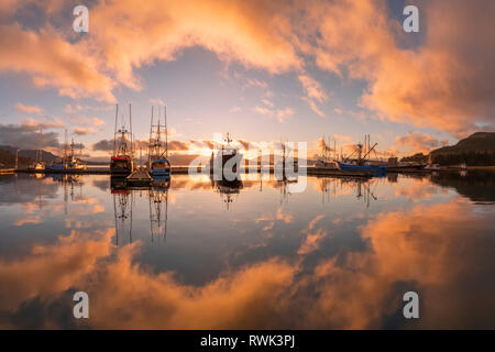 Commercial fishing boats in Auke Bay at sunset, Southeast Alaska; Juneau, Alaska, United States of America - Stock Image