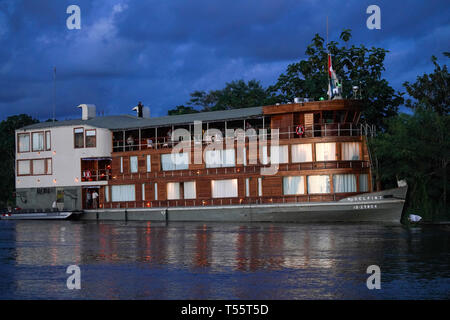 The Delfin 2 river boat takes travelers on cruises along the Amazon River - Stock Image