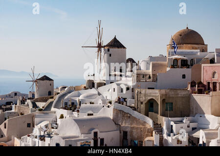 Windmills in Typical Oia Village Santorini Greece - Stock Image