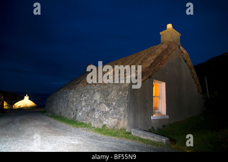The Garenin Trust traditional Scottish Blackhouse at night on the Isle of Harris Western Isles Outer Hebrides Scotland - Stock Image