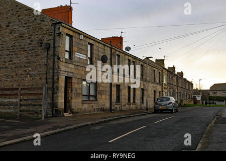 Terraced stone houses   Greenfield Terrace Amble   Amble is a small town on the north east coast of Northumberland in North East England. Cw 6652 - Stock Image