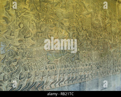 Frieze on inside wall of magnificent ruins of Angkor Wat Cambodia Asia an architectural masterpiece and largest religious monuments in the world - Stock Image