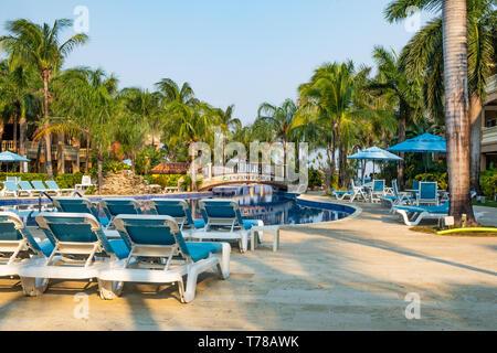 The swimming pool area of Infinity Bay Spa and Resort in Roatan Honduras. - Stock Image