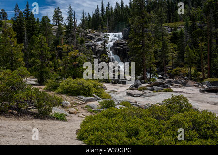Bassi Falls at the Eldorado National Forest, California, USA, in the beginning of the summer of 2019, viewed from a distance, featuring sierra vegetat - Stock Image