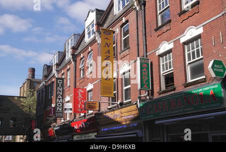 Indian Restaurant signs along Brick Lane London - Stock Image