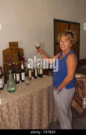 Armenia, Areni, woman tasting wine at Areni winery - Stock Image
