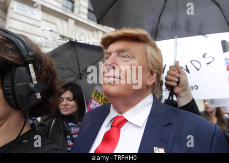A Donald Trump lookalike put on by the television Channel ITV During a protest which coincides with Donald TrumpÕs state visit to the United Kingdom on 04/06/2019 - Stock Image