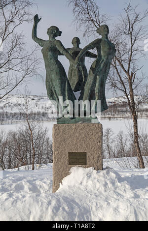 Statue of three women looking out for birds, outside the Borderland Museum in Kirkenes, Norway. - Stock Image