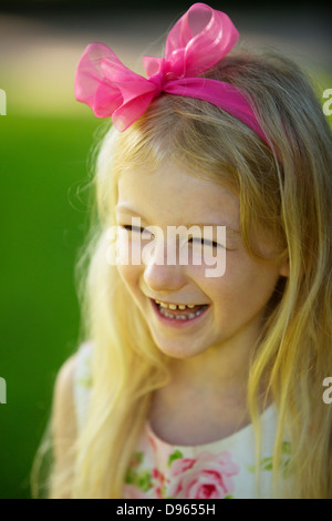 Pretty little girl smiling, portrait - Stock Image