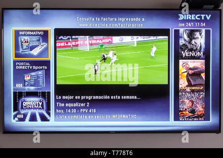 Cartagena Colombia TV television monitor screen flat screen DirecTV programming guide Spanish language - Stock Image