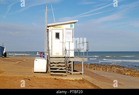 The RNLI Lifeguards hut on the seawall in North Norfolk at West Runton, Norfolk, England, United Kingdom, Europe. - Stock Image