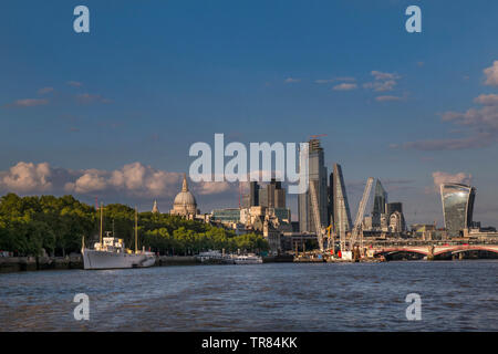 London Financial Centre vista Cityscape with construction cranes Saint Paul's and River Thames viewed from River Thames commuter boat London UK - Stock Image