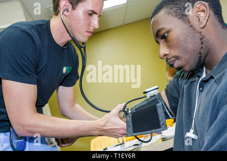 Miami Florida Liberty City Jessie Trice Community Health Center fair free care exam volunteer vital sign blood pressure arterial - Stock Image