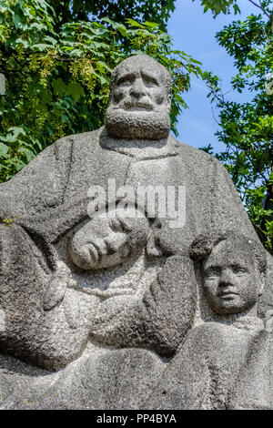 Statue Of man Woman and Child Alesund Norway - Stock Image