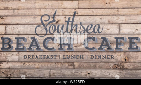 Southsea beach cafe sign on a wooden background - Stock Image
