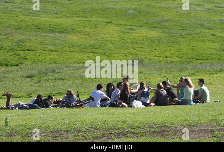 Young people having picnic Hampstead Heath London summer 2010 - Stock Image