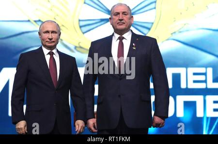Moscow, Russia. 27th Feb, 2019. Russian President Vladimir Putin stands with Vladimir Kovtun after presenting him the Hero of Russia Star at a gala marking the Day of Russian Special Operations Forces February 27, 2019 in Moscow, Russia. Kovtun was awarded the medal for his part in a special operation in Afghanistan. Credit: Planetpix/Alamy Live News - Stock Image