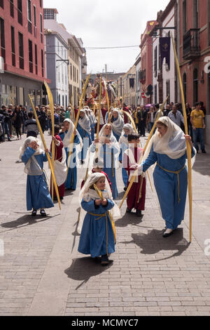 Tenerife, Canary Islands, girls and boys walk out of Cathedral of San Cristobal to lead the Palm Sunday Holy Week procession through the streets of La Laguna. - Stock Image