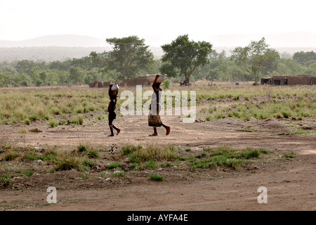 Children fetch water Wechiau Northwestern Ghana - Stock Image