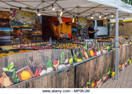 A Spanish food seller offering a variety of paella at a street market in Fleet, Hampshire, UK - Stock Image