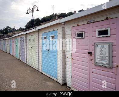 Beach huts in subtle colours on Marine Parade in Lyme Regis, on the Jurassic Coast, Dorset, England - Stock Image