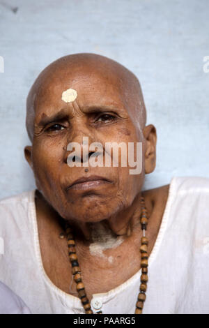 Old Hindu widow woman with tilak in Vrindavan , India - Stock Image