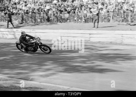 Motorcycle racing at Crystal Palace near London in 1968. A motorcycle racer, number 54, approaching in to a bend on the track. The Crystal Palace racing circuit was closed in 1972. - Stock Image