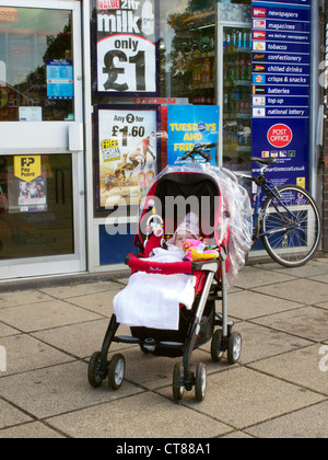 Baby left in pushchair in a poor area. Caldecott, Abingdon, Oxfordshire. Model Released. - Stock Image