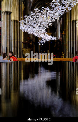 Salisbury, UK. 22nd July 2018 The last day of the art exhitbition. Artist Michael Pendry created the Les Colombes artwork. Around 3,000 origami birds have been put up in the building to spread hope and positivity. Credit: © pcp/ Alamy Stock Photo (Default)/Alamy Live News - Stock Image
