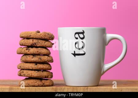 tea and cookies, mug of tea with chocolate chip cookies - Stock Image