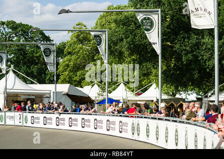 Spectators watching the Brompton '48 Invitational bicycle racing event at Herne Hill Velodrome on a sunny Summer day, UK - Stock Image