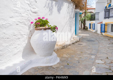 Beautiful traditional street in a quiet greek town. - Stock Image