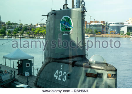 The USS Torsk, a US Navy submarine from World War II, is docked next to the National Aquarium at the Inner Harbor in Baltimore, Maryland USA - Stock Image